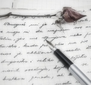 love letter with a rose and pen